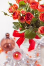 Orange roses in vase on on white background toning vintage style Stock Photos