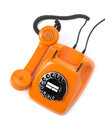 Orange rotary phone on white background Stock Image