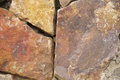 Orange rough cracked stone texture background Royalty Free Stock Photo