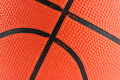 Orange rubber basketball macro background Stock Photo