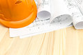 Orange safety helmet and project drawings Royalty Free Stock Photo