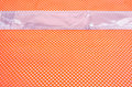 Orange safety mesh with reflective tape an vest material a used in construction and road work Stock Photos