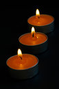 Orange scented candles lit for parties Royalty Free Stock Photo
