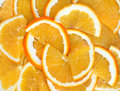 Orange segments background from close up Stock Photos