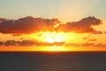 Orange sky at sea by sunrise Royalty Free Stock Photo