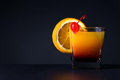 Orange slice and glass of juice