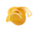 Orange slice and peel composition over the white background Stock Photos