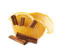 Orange slice and peel isolated cinnamon stick composition over the white background Stock Photos