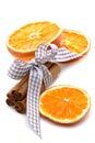Orange slices cinnamon against white 免版税库存照片