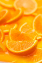 Orange slices in juice food background Royalty Free Stock Images
