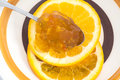 Orange slices and marmalade on a spoon Stock Image