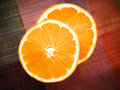Orange slices on a table Stock Image