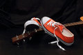 Orange sneakers and guitar Royalty Free Stock Photo