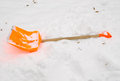 Orange snow clean tool lie rest snowdrift winter Royalty Free Stock Image