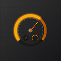 Orange speedometer on carbon background