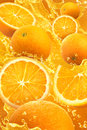 Orange splash fruit and water with background Stock Images