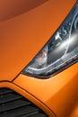 Orange sport car close-up Royalty Free Stock Photo
