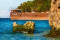 Orange steel pier on tropical sea with rocks Philippines