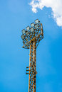 Orange steel tower stadium lights old on blue sky backgrounds Stock Image
