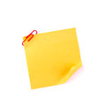 Orange sticky paper note with a red clip Royalty Free Stock Photo