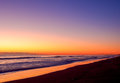 Orange sunrise color on the long beach line Royalty Free Stock Photos