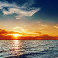 Orange sunset over darken sea blue and Royalty Free Stock Photography