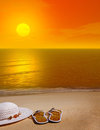 Orange sunset over sandals sandy beach Stock Photography
