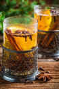 Orange tea with cinnamon and cloves on old wooden table Stock Images