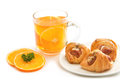 Orange tea with little croissant break Stock Photography