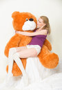 Orange teddy bear young blond woman with a big Stock Images