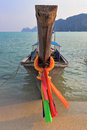Orange Thai tourist boat moored on the beach Royalty Free Stock Photo