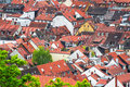 Orange tiled roofs and brown rooftops pattern in old city Stock Images