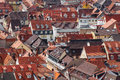 Orange tiled roofs and red rooftops pattern in old city Stock Photography