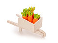 Orange toy carrot in a wooden shopping cart  with Clipping Path Royalty Free Stock Photo