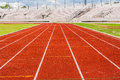 Orange track blank in the stadium runway on the side of football field Stock Photo