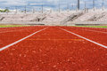 Orange track dog eye view blank in the stadium runway on the side of football field in the low Stock Photo