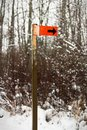 An orange trail marker sign along a hiking path Royalty Free Stock Photo