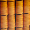 Orange tread reels arranged orderly in a wooden box with selective focus Royalty Free Stock Images