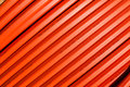 Orange tubing sixty degree lines close up photo image of colored at degrees across horizontal frame Royalty Free Stock Image