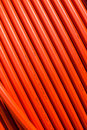 Orange tubing sixty degree vertical close up photo image of colored at degrees across frame Stock Photography
