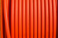 Orange tubing vertical lines close up photo image of of colored Royalty Free Stock Photo