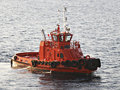 Orange tug/pilot boat Stock Photography