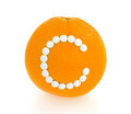 Orange with vitamin c pills over white background Stock Images