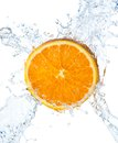 Orange and water splash on a white background see my other works in portfolio Stock Photos