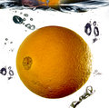 Orange in water splashing into on white Royalty Free Stock Photo