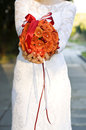 Orange wedding bunch of flowers bright red and roses in a bouquet Stock Photos