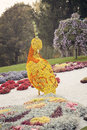 Orange yellow bird flower sculpture – flower show in ukraine beautiful large and made of flowers at the th annual exhibition Stock Photo