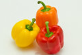 Orange, Yellow, and Red Bell Peppers Royalty Free Stock Photo