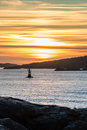 Orange and yellow sky above harbor port coast sunset sailing boa Royalty Free Stock Photo