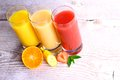 Oranges bananas strawberry slice and juice in glass writing space top view with Stock Photos